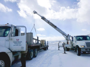 Photo: West Shore Services flat bed and boom trucks installing warning sirens in Wyoming for a museum's fire alert system.